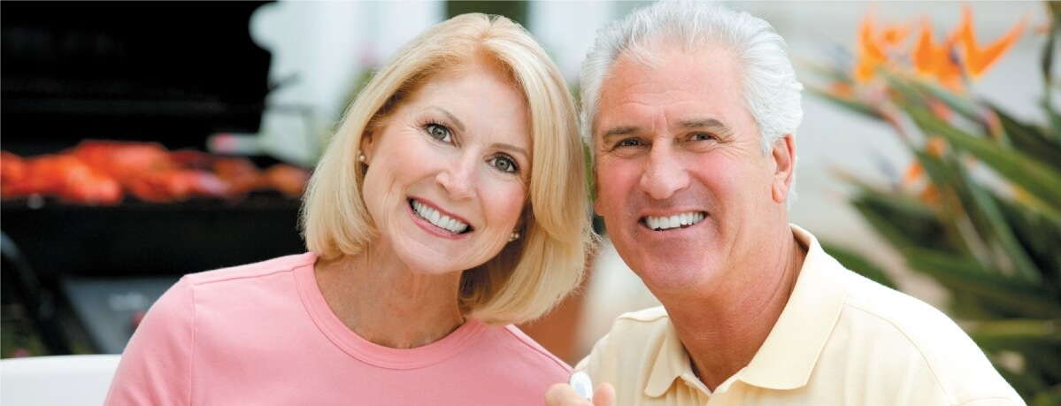 Retired couple with dental implants