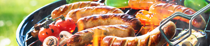 BBQ sausages cooking on the grill