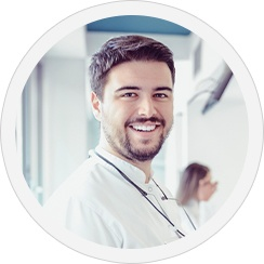 smiling man in scrubs
