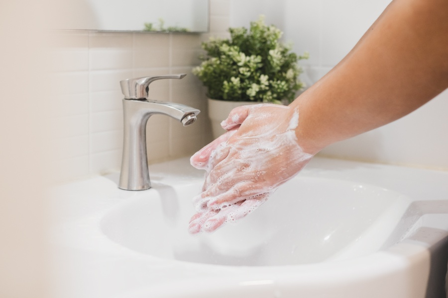 Closeup of a person washing their hands for 20 seconds to reduce the spread of COVID-19 in Littleton, CO
